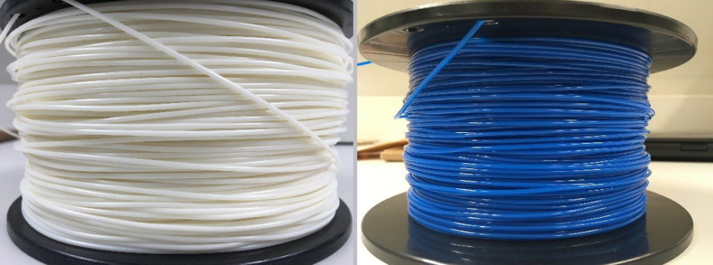 Two rolls of printable plastic wire.